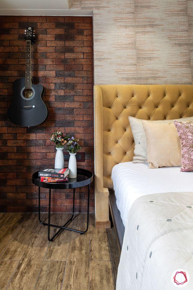 beige headboard-brick tile walls-bedside table