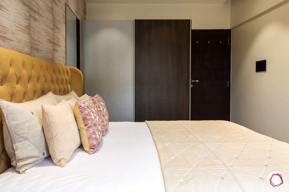 home renovation mumbai-beige headboard-textured wallpaper