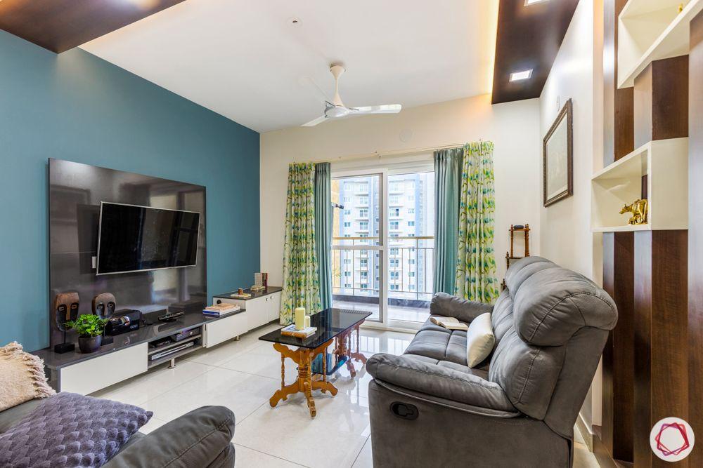 3-bhk-flat-interior-design-living room-laminate tv unit-blue wallpaper