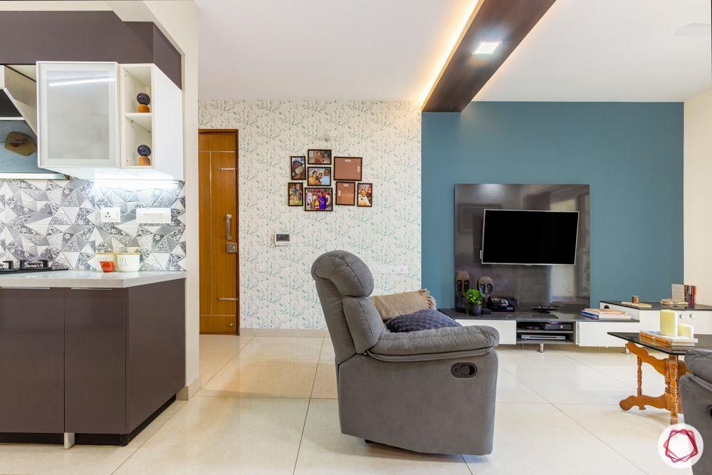 3-bhk-flat-interior-design-living room-printed wallpaper-photo wall-grey recliner sofa
