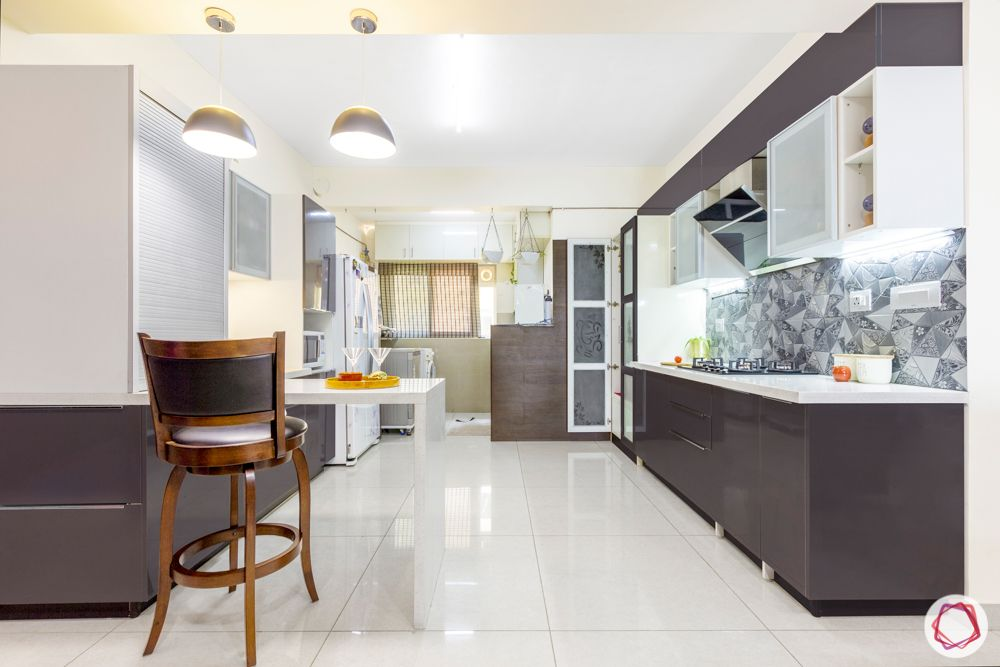 3-bhk-flat-interior-design-kitchen-breakfast counter-pendant lights-open kitchen