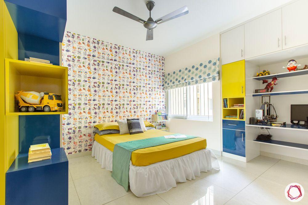 3-bhk-flat-interior-design-kids bedroom-blue shelves-yellow shelves