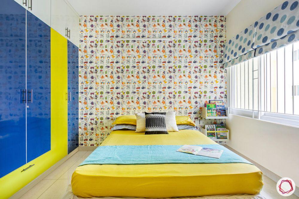 3-bhk-flat-interior-design-kids bedroom-printed wallpaper-blue yellow wardrobes