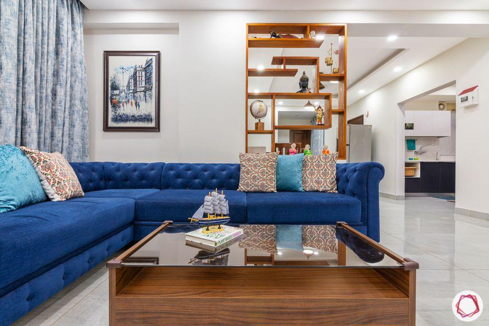 3bhk interior design-blue sofa design-laminate partition design