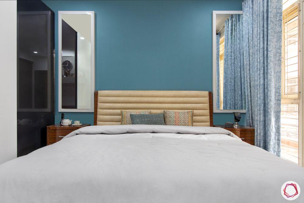 blue wallpaper design-white framed mirror