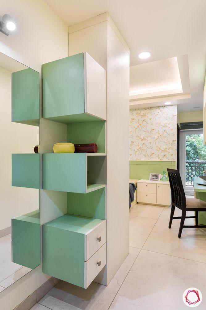 bedroom designs-bed designs-pastels green-florals wallpaper-vanity unit