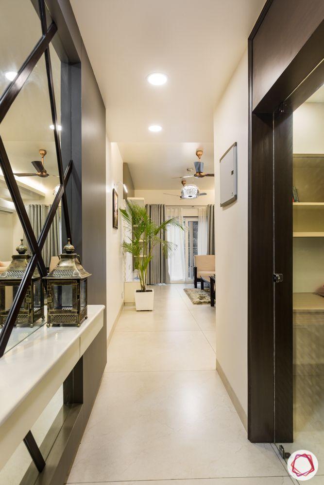 interior 3bhk for flat-passageway-mirror panelling-wooden designs-lantern