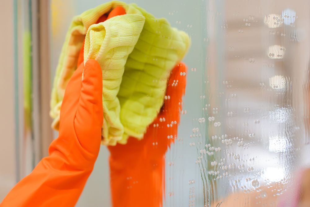 how to clean bathroom-orange glove-mirror