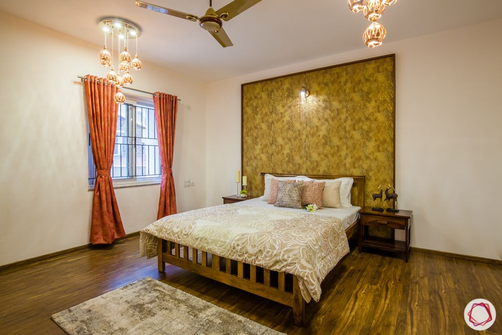western hills baner-gold accent wall-wooden flooring-pendant lights-wooden bed-side table
