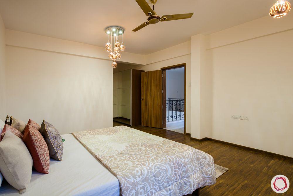 western hills baner-master bedroom-pendant lights-wooden bed