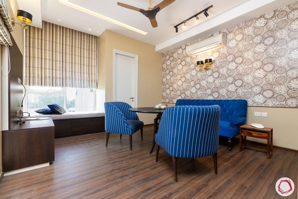 blue armchair designs-brown wallpaper designs-bay seating ideas