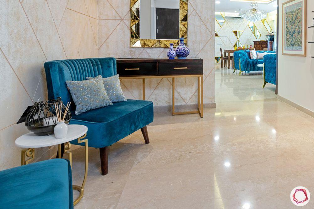 blue armchair designs-foyer designs-ceramic plates on walls