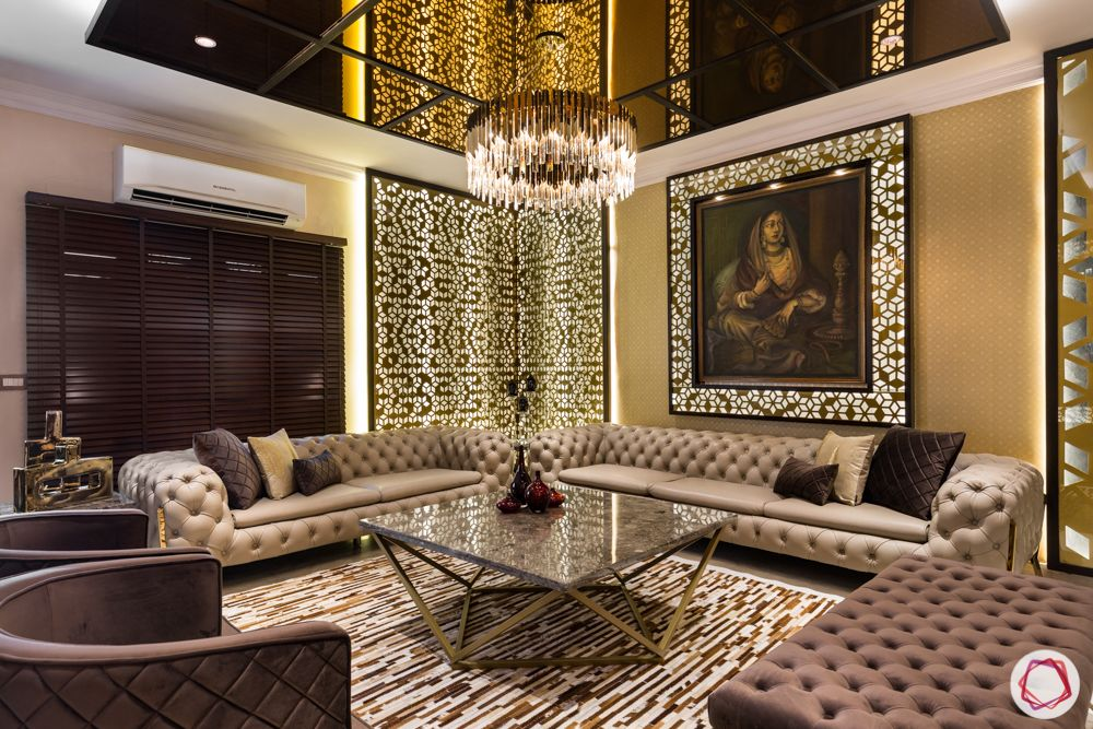 luxury-living-room-interiors-tufted-sofas-chandelier- coffee-table-bench