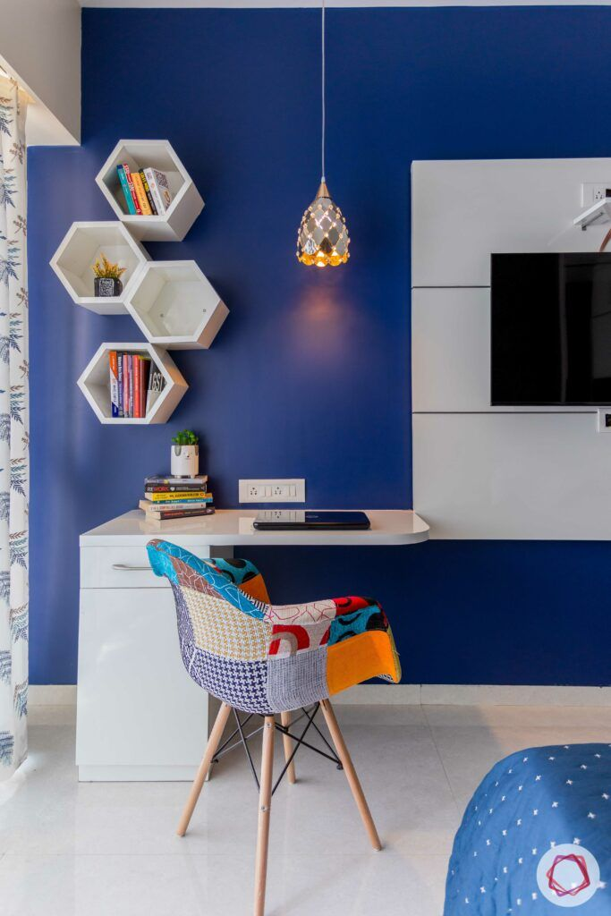 study room lighting-pendant light-blue accent wall-white hexagonal shelves