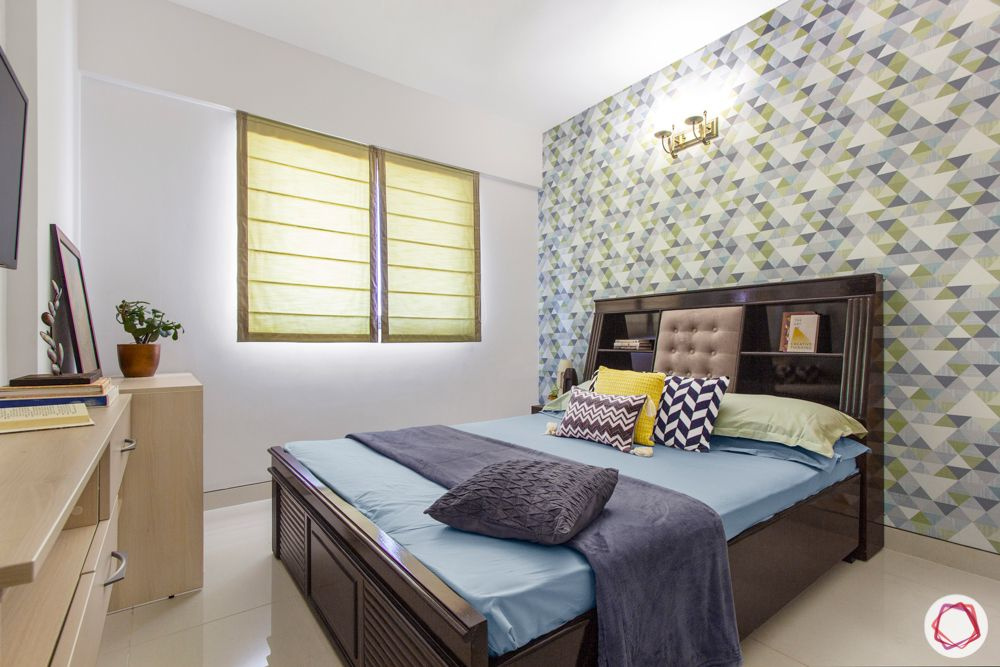 snn raj etternia-guest bedroom-wooden bed-existing bed-colourful wallpaper