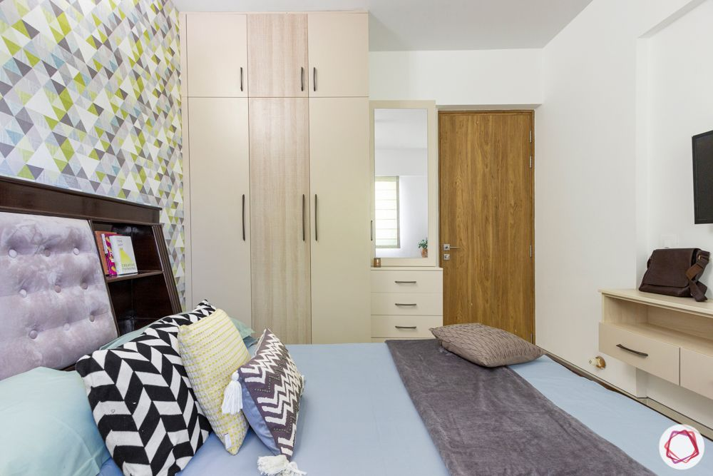 snn raj etternia-guest bedroom-laminate wardrobe-black and white cushion-colourful wallpaper