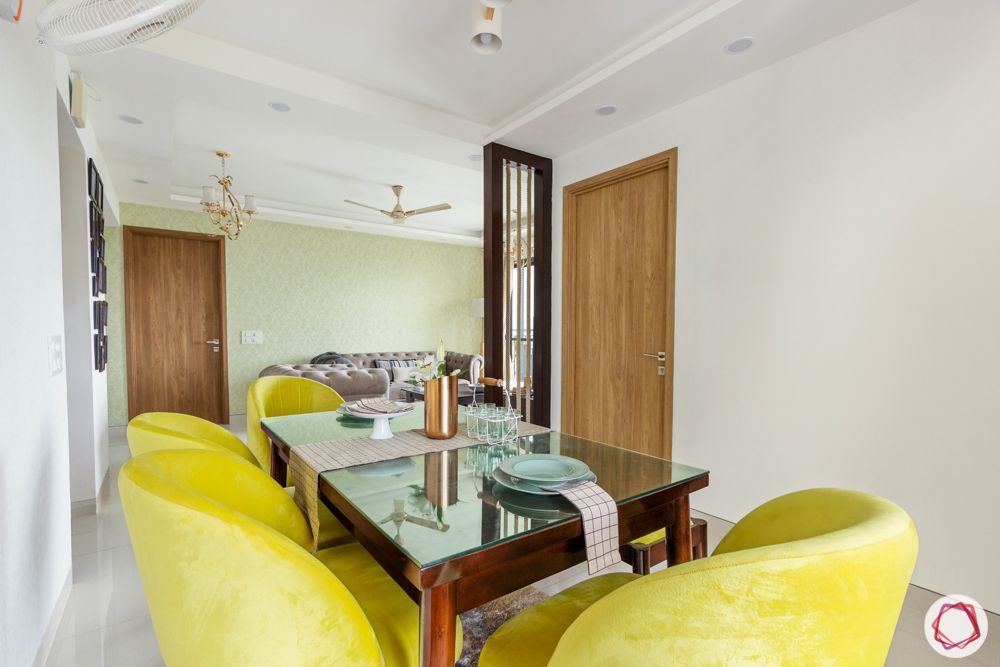 snn raj etternia-dining room-yellow chairs-partition-chandelier