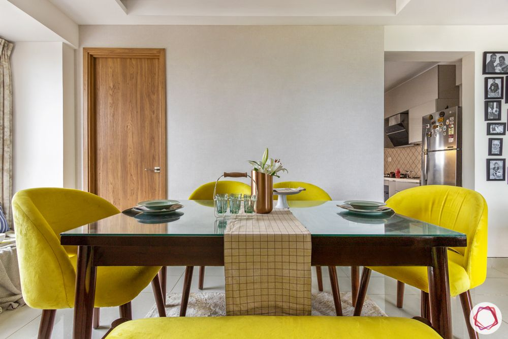 snn raj etternia-dining room-flower pot-dining table designs-yellow chairs