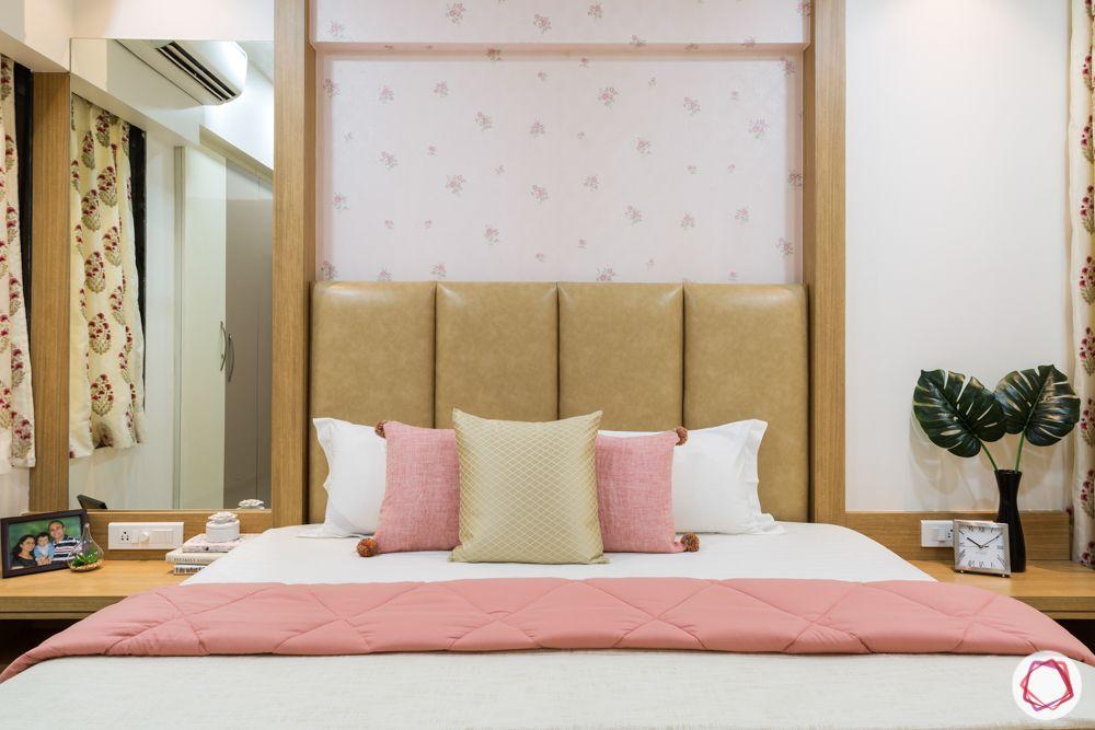 master bedroom-custom bed-pastel wallpaper-leather headboard-mirror-side table