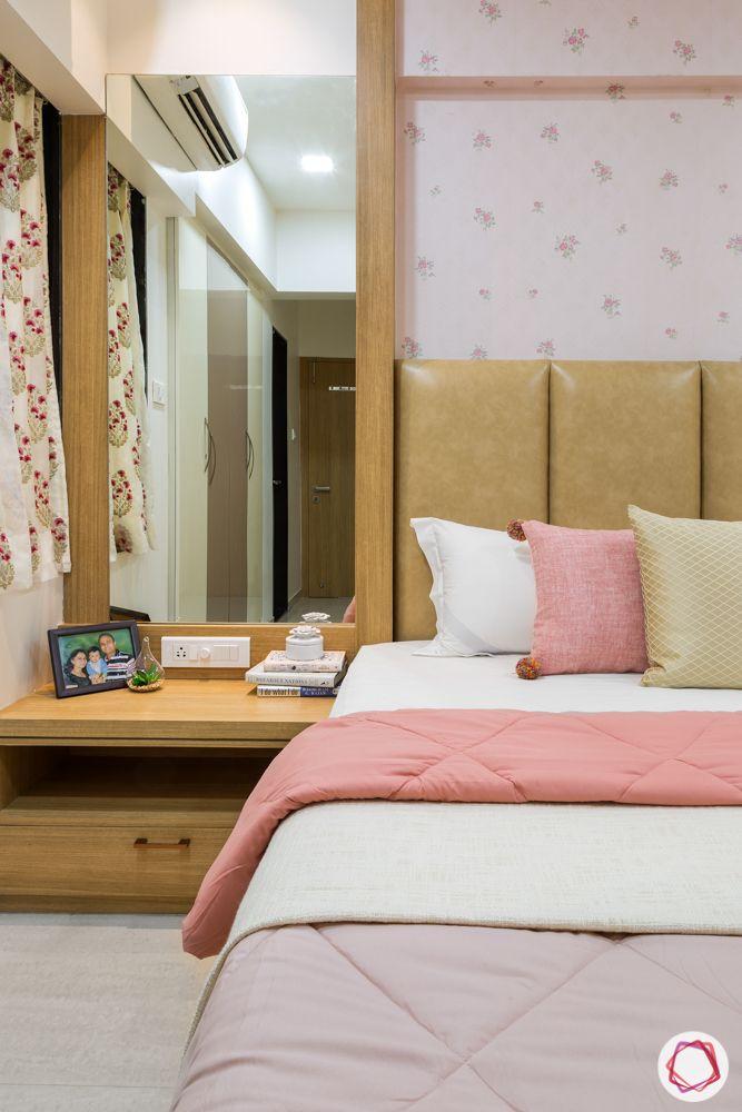 2bhk flat design-master bedroom-custom bed-pastel wallpaper-sideboard and mirror