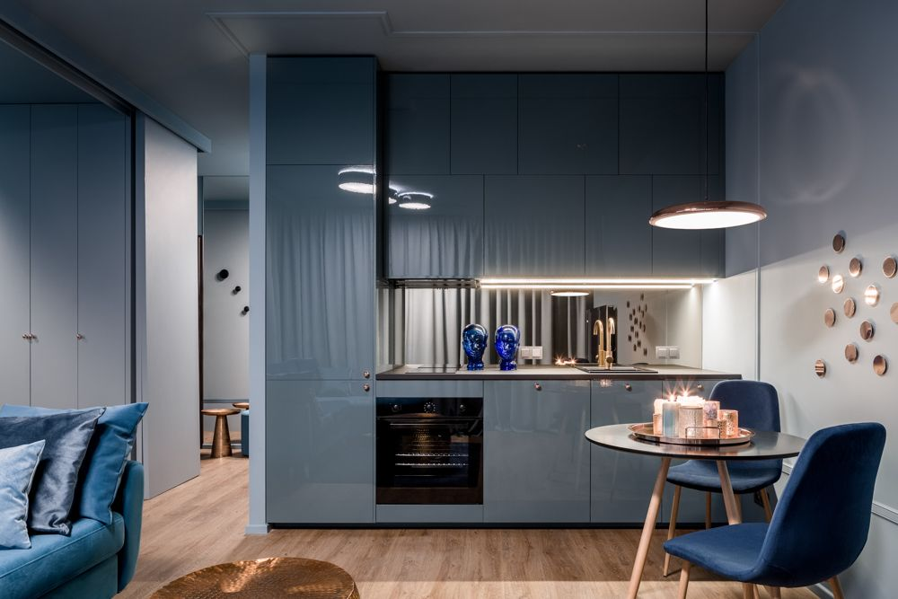 blue chair-grey kitchen cabinets