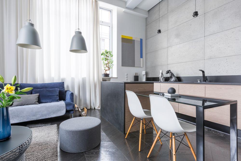 white chairs-blue sofa-pendant lights