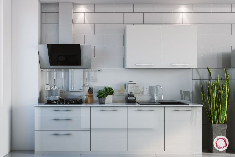 white cabinets-white tile wall