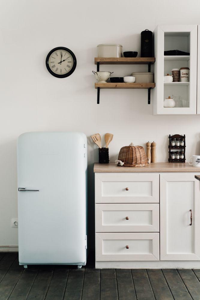 kitchenette-wall clock-fridge-cabinets