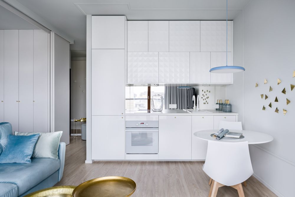 kitchenette-white kitchen cabinets-white chair