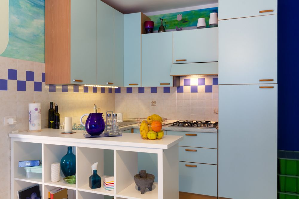 kitchenette-white shelf-blue cabinets