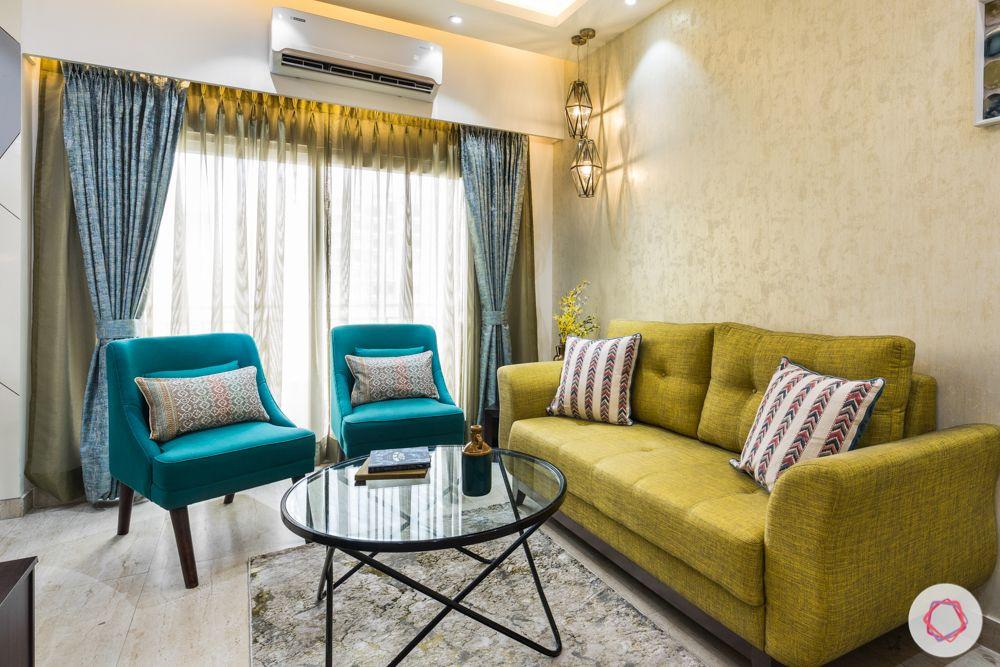 Panchsheel-Pratishtha-living-room-sofas-yellow-blue-coffee-table