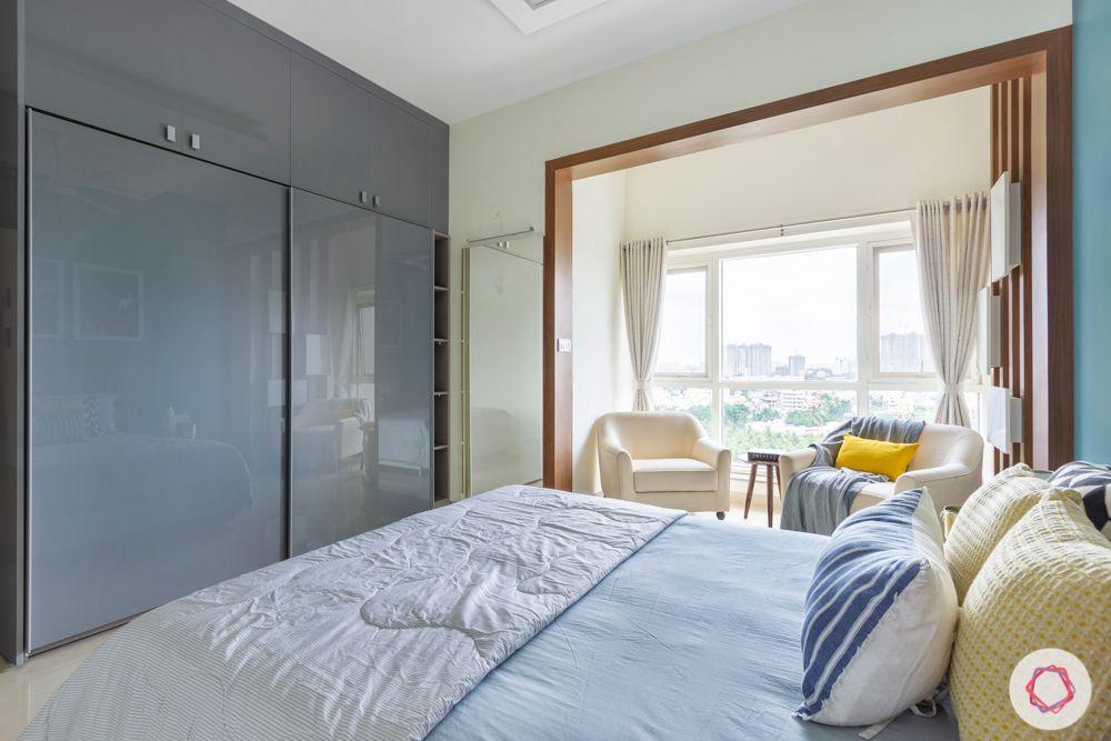 grey acrylic wardrobe shutter-seating area in bedroom