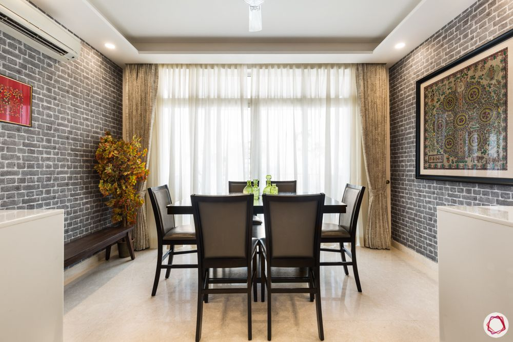 4 bhk apartment-dining table designs-window in dining room-grey brick wall