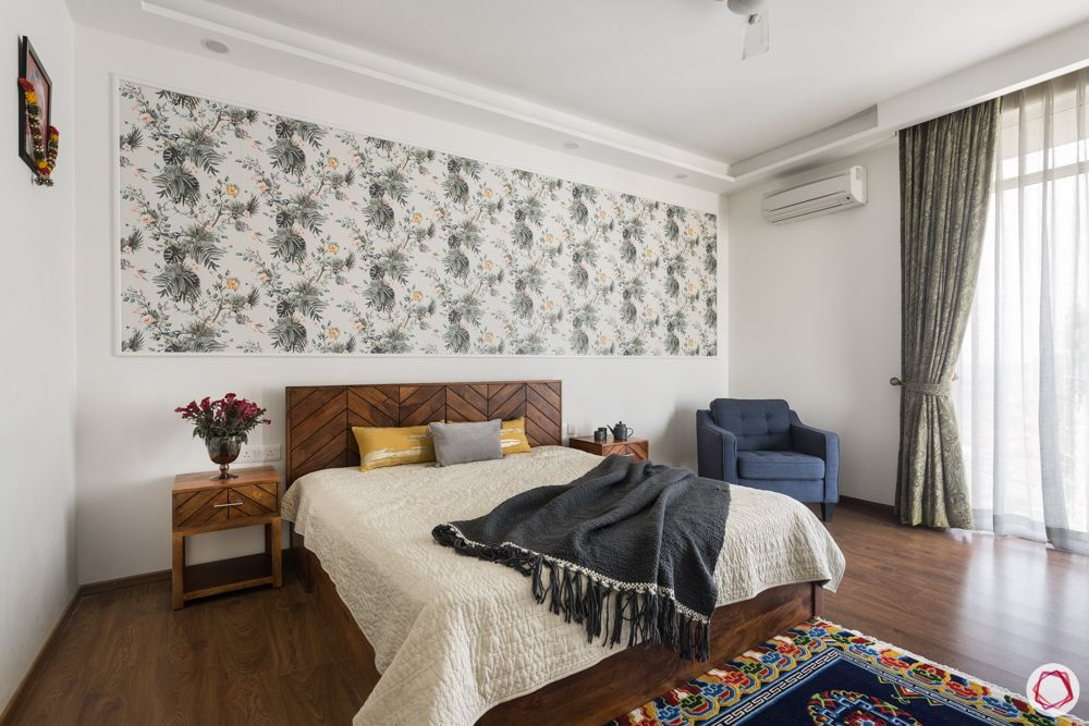 4 bhk apartment-wooden bed-floral wallpaper-white walls