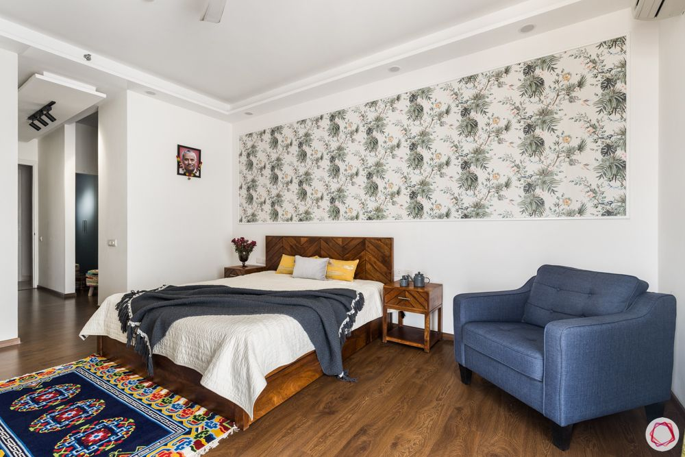 4 bhk apartment-wooden bed-floral wallpaper-white walls-blue chair