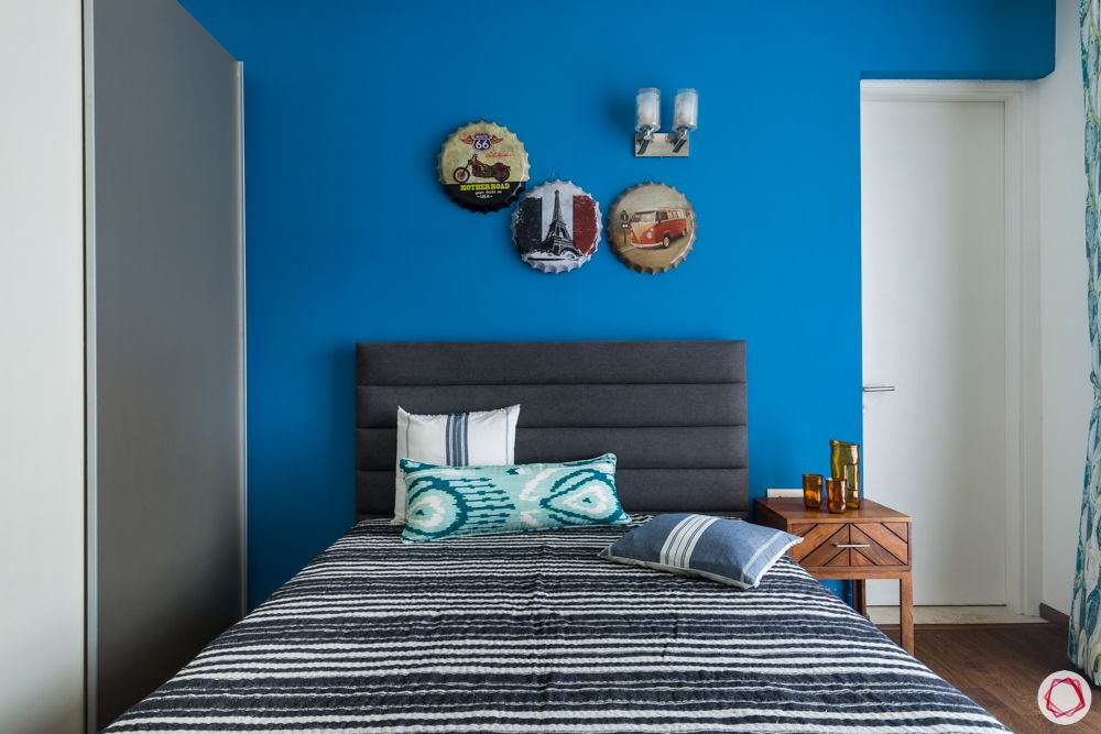 4 bhk apartment-grey headboard- blue and white wardrobe designs-blue walls-wall art