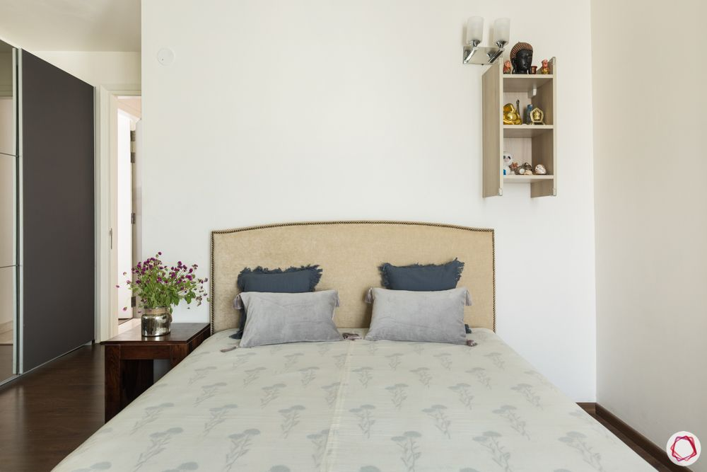 4 bhk apartment-beige bed-white walls-wooden side table-wardrobe designs