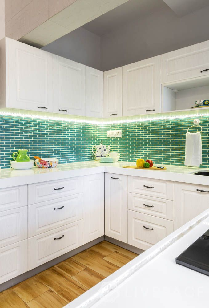 make your home look expensive-white kitchen-profile lighting for kitchen cabinets