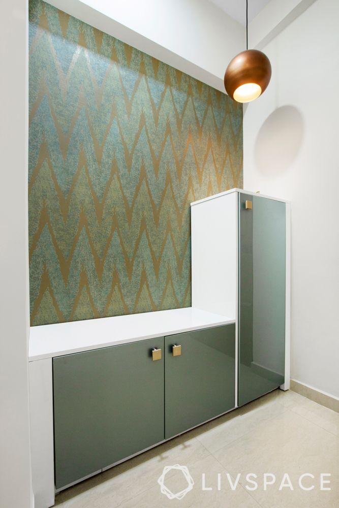 Foyer design-green pattern wallpaper-shoe cabinet-pendant light