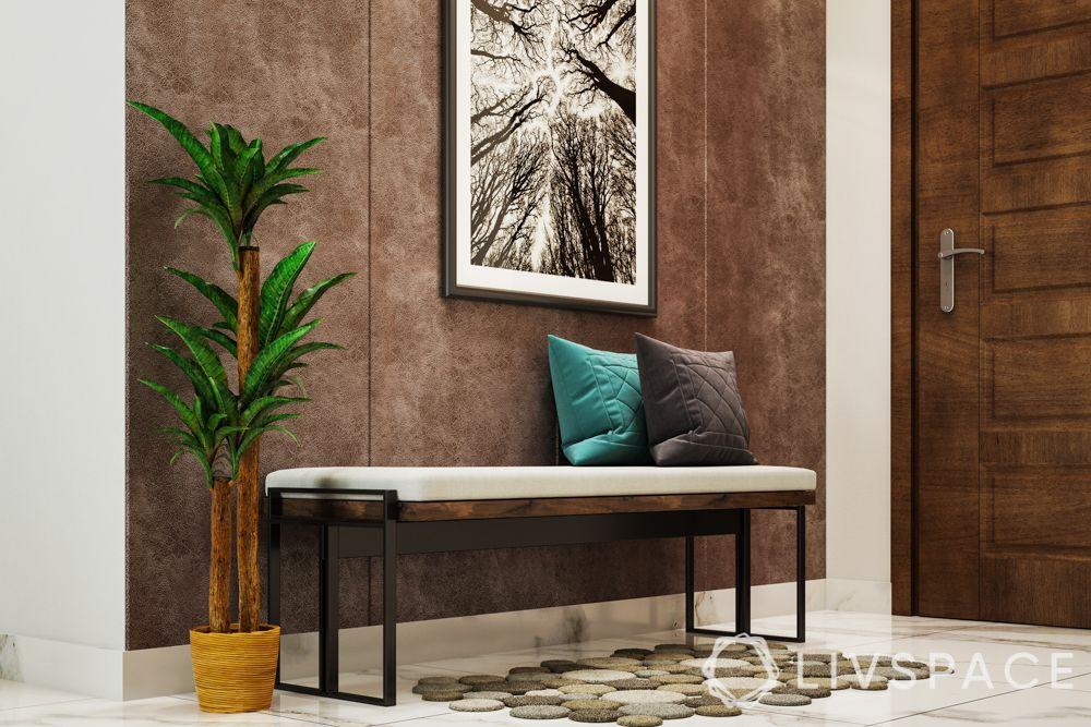 foyer design-artwork-bench-brown wallpaper-wooden door