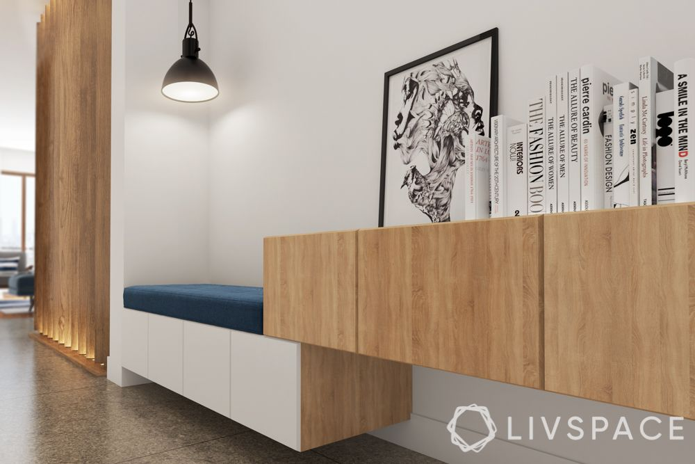 Foyer design-pendant lights-black and ehite books-wooden cabinets
