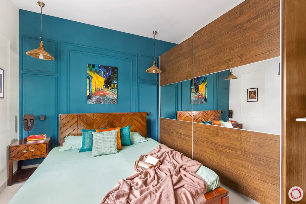 sobha-aspire-master-bedroom-turquoise-wall-laminate-sliding-wardrobes
