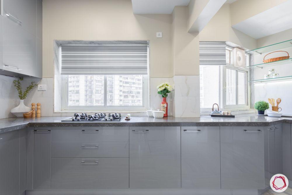 Modular kitchen laminates-metallic-grey-cabinets-stove-glass-shelves