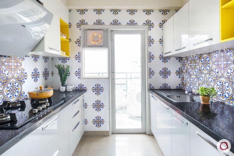 Modular kitchen laminates-glossy finish-white-floral-black-counter