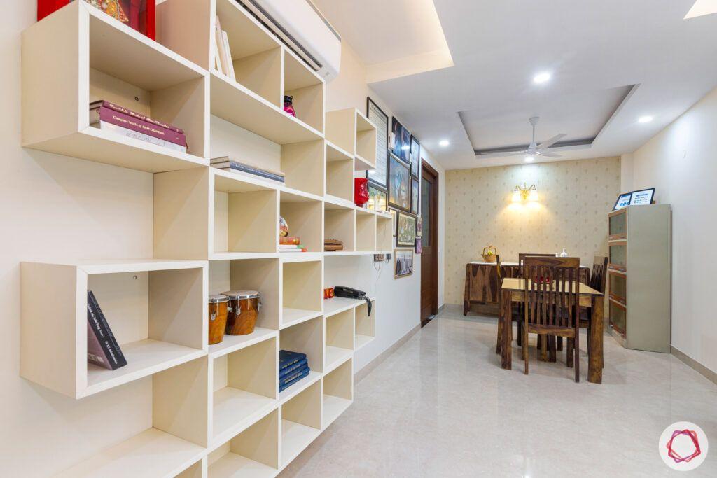 interior-in-gurgaon-dining-room-bookshelf-wall-paintings