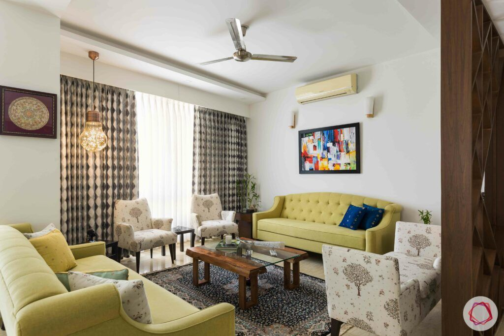 livspace gurgaon-yellow sofa designs-white armchair designs