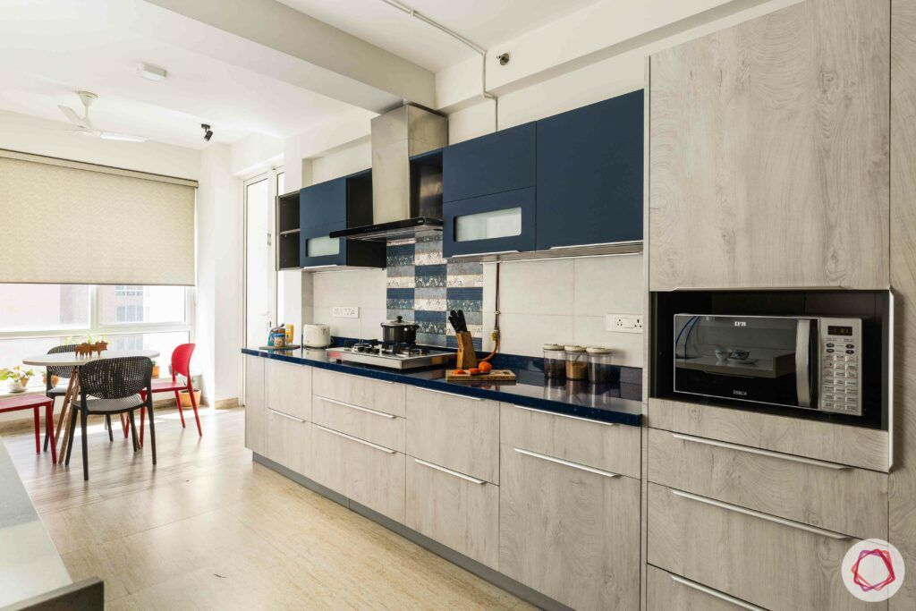 livspace gurgaon-blue wall cabinets-tall unit designs