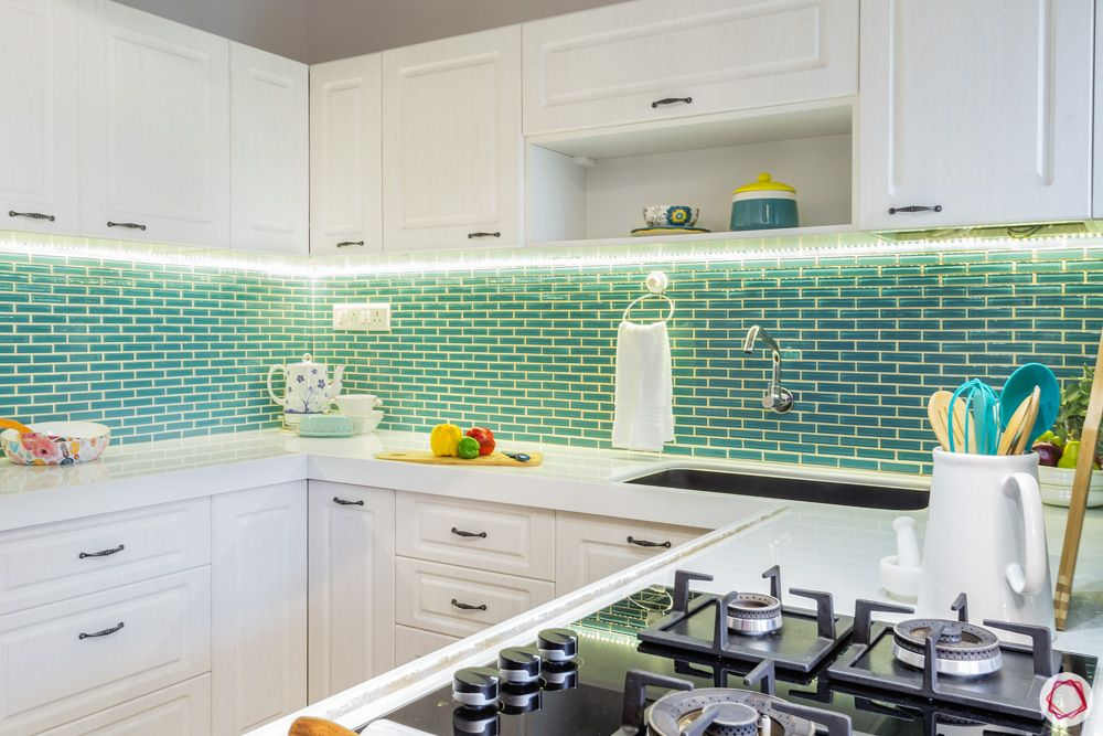 livspace home interiors-white kitchen designs-blue kitchen tiles