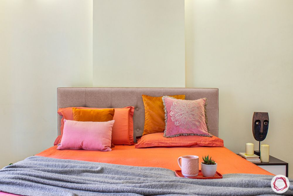 Salarpuria-Sattva-Aspire-hometour-bed-orange-sheet-pillow