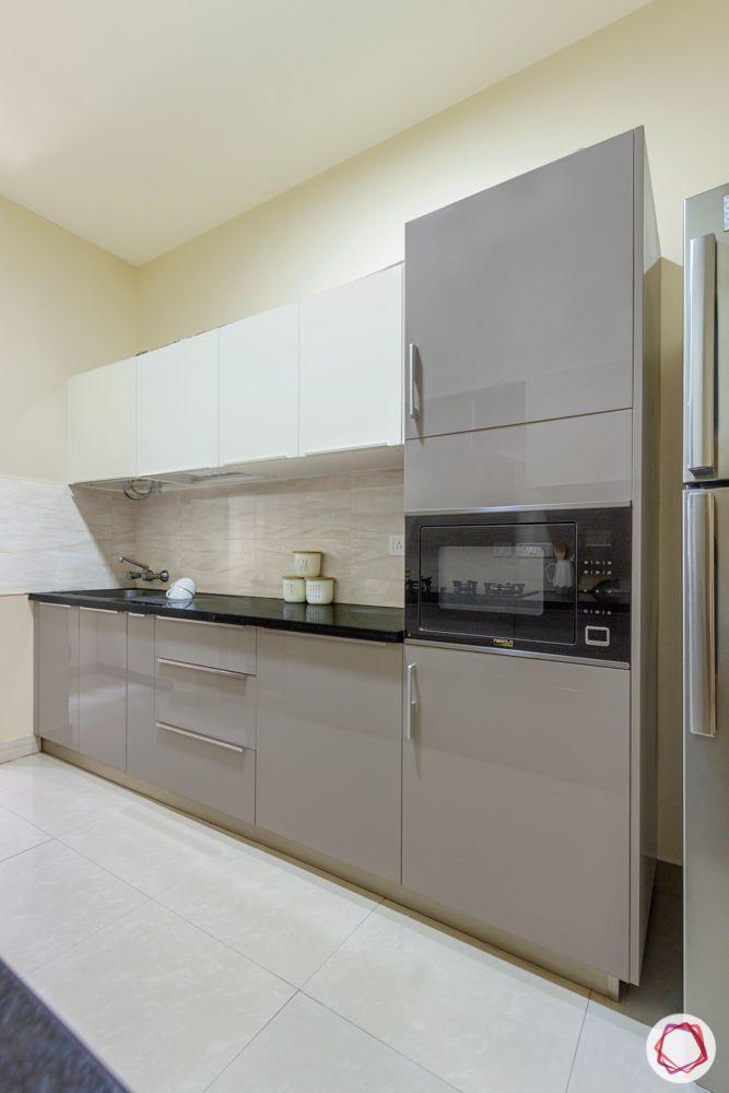 Salarpuria Sattva Aspire-kitchen-cabinets-white-grey-tall-unit